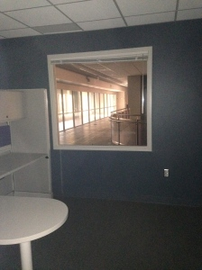This is the view through the one way mirror in the psychiatrist's office looking out into our clinic.  Don't act crazy!
